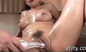 Cute japanese with sexy whoppers masturbates solidly with toys