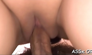 Asian darling gets moist facial after raucous anal bang