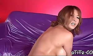 Asian with scrupulous breasts enjoys ballpark toying increased by bawdy pounding