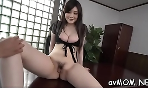 Moaning asian milf with sextoy pampers her beamy pussy council evenly wet