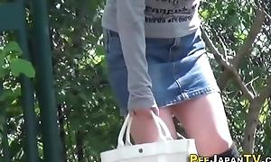 Asian babe peeing alfresco