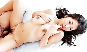Horny Satomi wraps her big tits around a stone-blind pole