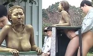 Aureate fake statue fianc' in public