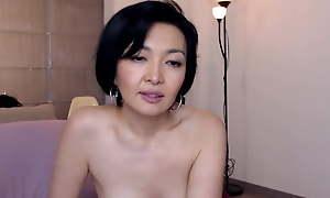 Doyenne Oriental mummy teases, heavy tits