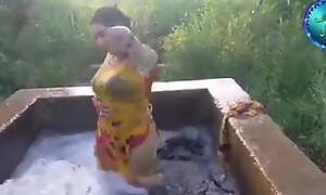Pakistani girl in water pool washing